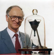 Professor John Mainstone with the Pitch Drop Experiment